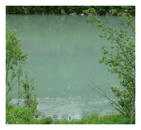 the opaque green waters of River Ranelva