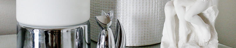 Owen Polished Chrome Touch Lamp, white H&M ceramic pot, Zoola chrome fox ring holder & The Kiss sculpture